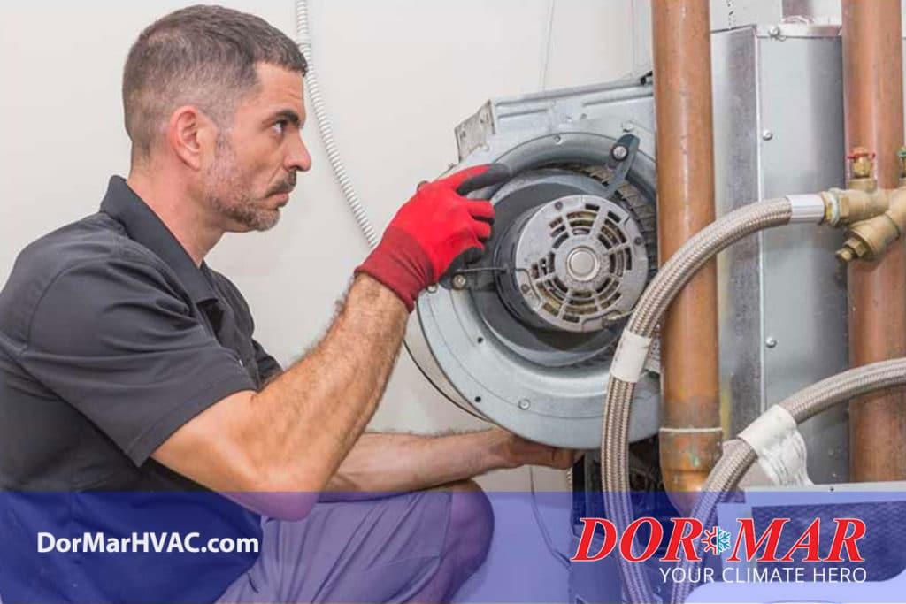 HVAC technician removing furnace blower